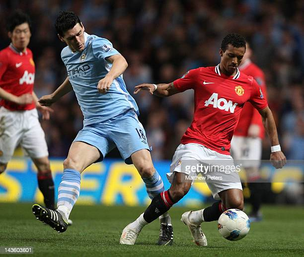 Nani of Manchester United clashes with Gareth Barry of Manchester City during the Barclays Premier League match between Manchester City and...