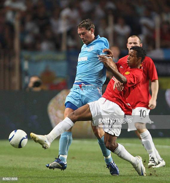 Nani of Manchester United clashes with Ivica Krizanac of Zenit St Petersburg during the UEFA Supercup match between Manchester United and Zenit St...