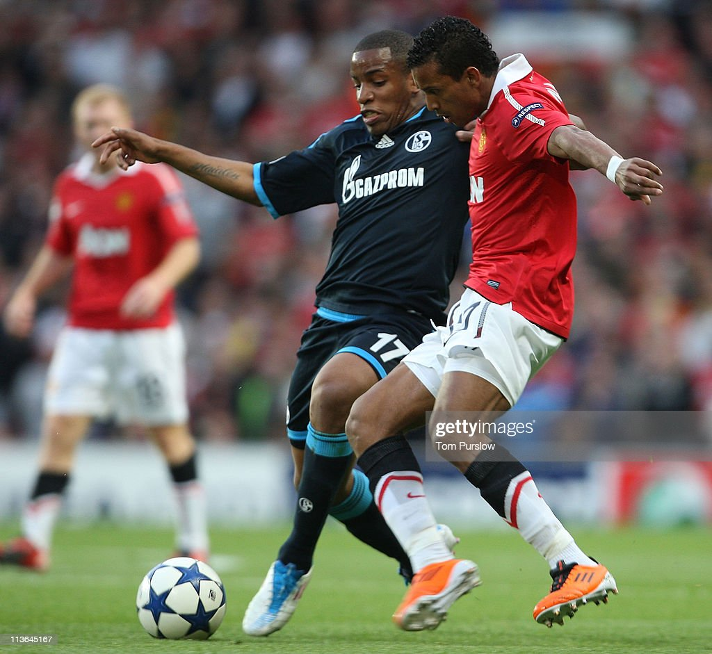 Nani of Manchester United clashes with Jefferson Farfan of Schalke 04 during the UEFA Champions League SemiFinal second leg match between Manchester...