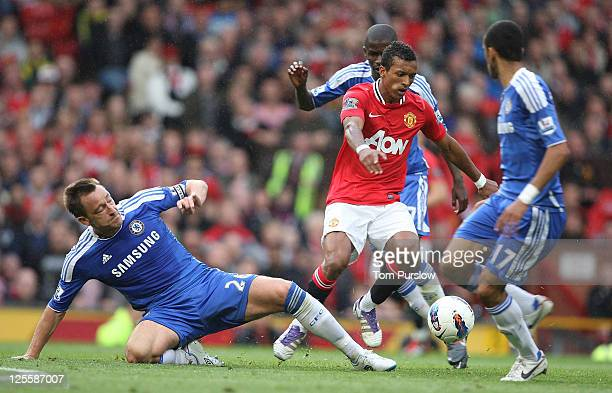Nani of Manchester United clashes with John Terry of Chelsea during the Barclays Premier League match between Manchester United and Chelsea at Old...