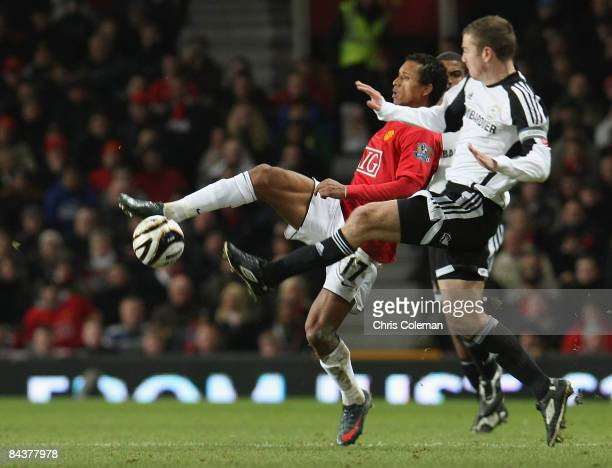 Nani of Manchester United clashes with Paul Connolly of Derby County during the Carling Cup SemiFinal 2nd Leg match between Manchester United and...