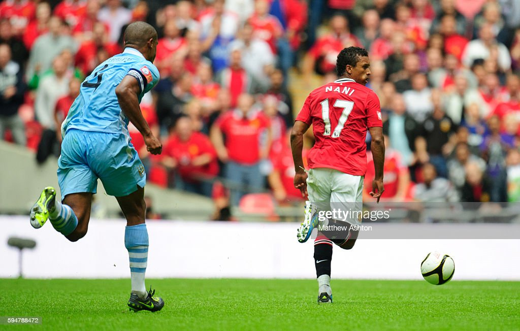 Nani of Manchester United gets away from Vincent Kompany of Manchester City to score the winning goal