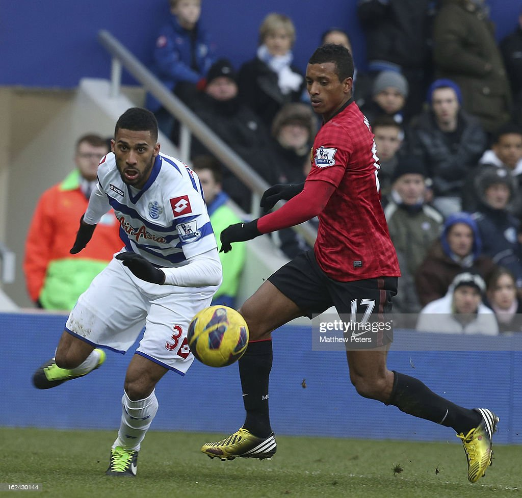 Nani of Manchester United in action with Armand Traore of Queens Park Rangers during the Barclays Premier League match between Queens Park Rangers and Manchester United at Loftus Road on February 23, 2013 in London, England.