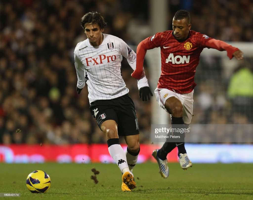 Nani of Manchester United in action with <a gi-track='captionPersonalityLinkClicked' href=/galleries/search?phrase=Bryan+Ruiz&family=editorial&specificpeople=714489 ng-click='$event.stopPropagation()'>Bryan Ruiz</a> of Fulham during the Barclays Premier League match between Fulham and Manchester United at Craven Cottage on February 2, 2013 in London, England.