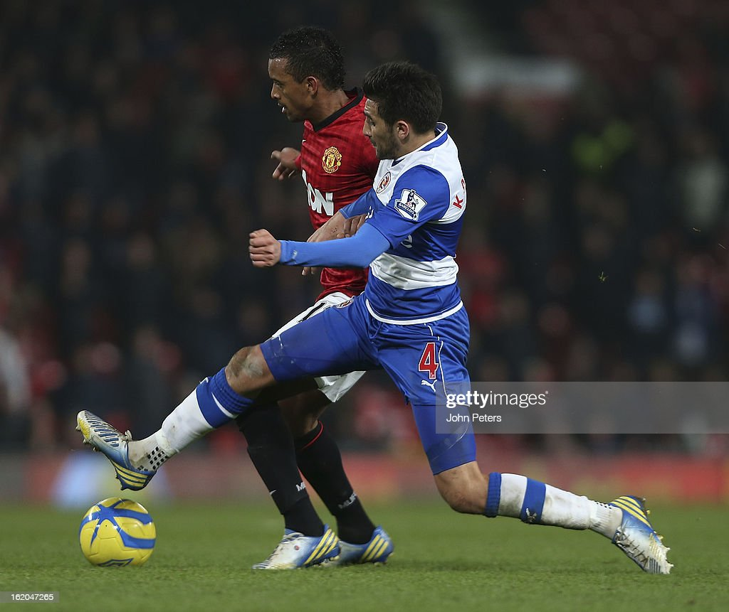 Nani of Manchester United in action with Jem Karacan of Reading during the FA Cup Fifth Round match between Manchester United and Reading at Old Trafford on February 18, 2013 in Manchester, England.