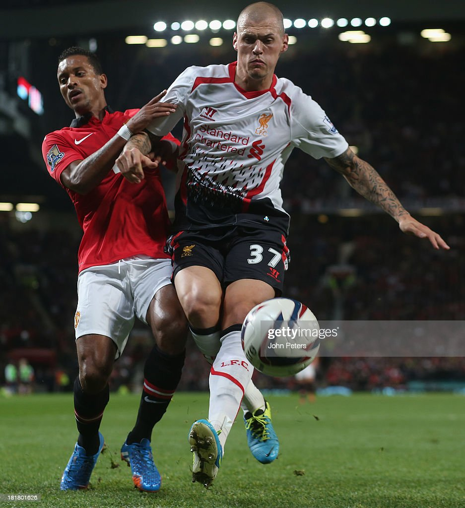 Nani of Manchester United in action with <a gi-track='captionPersonalityLinkClicked' href=/galleries/search?phrase=Martin+Skrtel&family=editorial&specificpeople=5554576 ng-click='$event.stopPropagation()'>Martin Skrtel</a> of Liverpool during the Capital Cup Third Round match between Manchester United and Liverpool at Old Trafford on September 25, 2013 in Manchester, England.