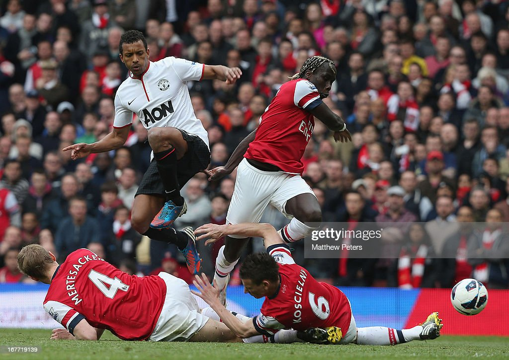 Nani of Manchester United in action with <a gi-track='captionPersonalityLinkClicked' href=/galleries/search?phrase=Per+Mertesacker&family=editorial&specificpeople=207135 ng-click='$event.stopPropagation()'>Per Mertesacker</a>, <a gi-track='captionPersonalityLinkClicked' href=/galleries/search?phrase=Laurent+Koscielny&family=editorial&specificpeople=2637418 ng-click='$event.stopPropagation()'>Laurent Koscielny</a> and <a gi-track='captionPersonalityLinkClicked' href=/galleries/search?phrase=Bacary+Sagna&family=editorial&specificpeople=745680 ng-click='$event.stopPropagation()'>Bacary Sagna</a> of Arsenal during the Barclays Premier League match between Arsenal and Manchester United at Emirates Stadium on April 28, 2013 in London, England.