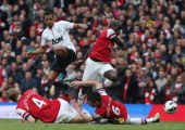 Nani of Manchester United in action with Per Mertesacker Laurent Koscielny and Bacary Sagna of Arsenal during the Barclays Premier League match...