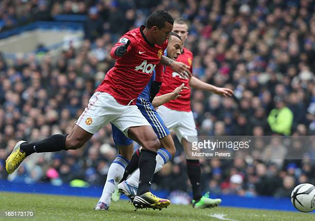 Nani of Manchester United in action with Ryan Bertrand of Chelsea during the FA Cup Sixth Round Replay match between Chelsea and Manchester United at...