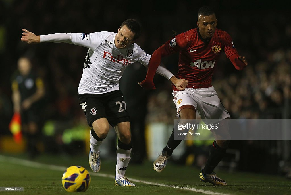 Nani of Manchester United in action with Sashcha Riether of Fulham during the Barclays Premier League match between Fulham and Manchester United at Craven Cottage on February 2, 2013 in London, England.