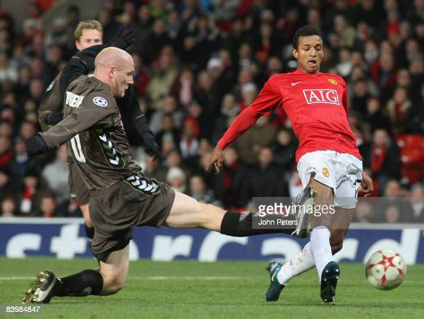 Nani of Manchester United is challenged by Kasper Bogelund of Aalborg during the UEFA Champions League Group E match between Manchester United and...