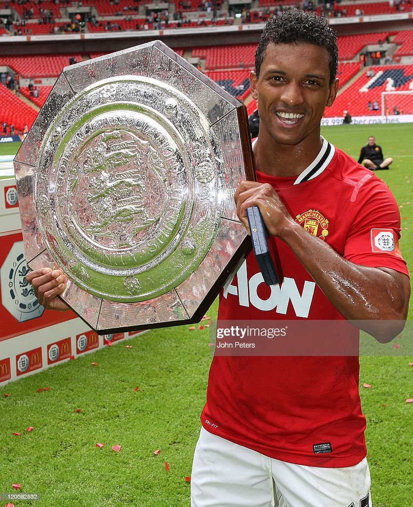 Nani of Manchester United poses with the Community Shield trophy after the FA Community Shield match between Manchester City and Manchester United at Wembley Stadium on August 7, 2011 in London, England.
