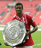 Nani of Manchester United posing for a photograph with the trophy following the FA Community Shield match between Manchester United and Portsmouth at...