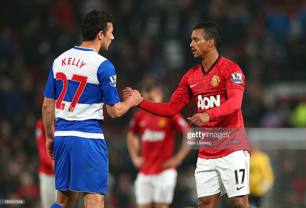 Nani of Manchester United shakes hands with Stephen Kelly of Reading after the FA Cup Fifth Round match between Manchester United and Reading at Old Trafford on February 18, 2013 in Manchester, England.