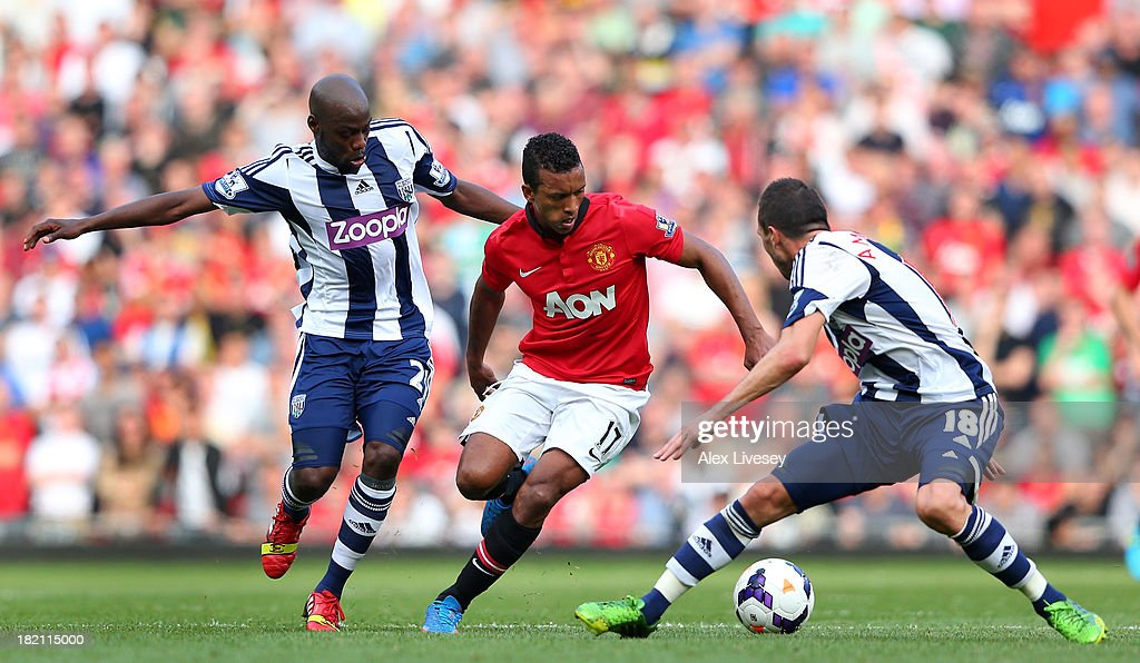 Nani of Manchester United takes on Youssouf Mulumbu and <a gi-track='captionPersonalityLinkClicked' href=/galleries/search?phrase=Morgan+Amalfitano&family=editorial&specificpeople=2528212 ng-click='$event.stopPropagation()'>Morgan Amalfitano</a> of West Bromwich Albion during the Barclays Premier League match between Manchester United and West Bromwich Albion at Old Trafford on September 28, 2013 in Manchester, England.