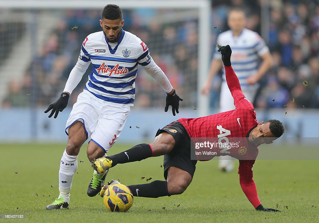 Nani of Manchester United tries to tackle Armand Traore of QPR during the Barclays Premier League match between Queens Park Rangers and Manchester United at Loftus Road on February 23, 2013 in London, England.