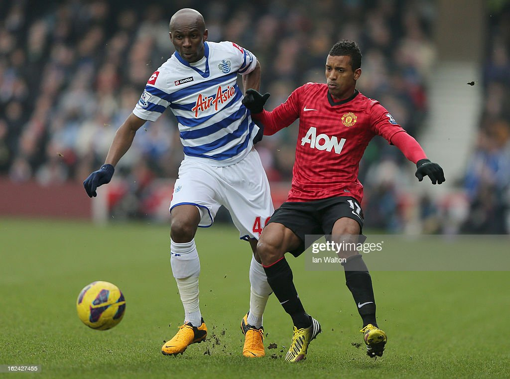 Nani of Manchester United tries to tackle Stephane Mbia of QPR during the Barclays Premier League match between Queens Park Rangers and Manchester United at Loftus Road on February 23, 2013 in London, England.