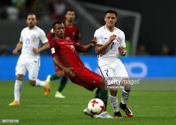 Nani of Portugal and Alexis Sanchez of Chile battle for possession during the FIFA Confederations Cup Russia 2017 SemiFinal between Portugal and...