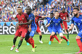 Nani of Portugal and Bacary Sagna of France during the European Championship Final between Portugal and France at Stade de France on July 10 2016 in...