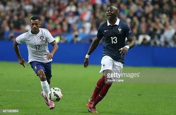 Nani of Portugal and Eliaquim Mangala of France during the International Friendly Soccer match between France and Portugal at Stade de France on...