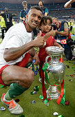 Nani of Portugal and his child celebrate withe the trophy after the UEFA EURO 2016 Final match between Portugal and France at Stade de France on July...