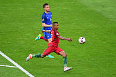 Nani of Portugal and Laurent Koscielny of France during the European Championship Final between Portugal and France at Stade de France on July 10...