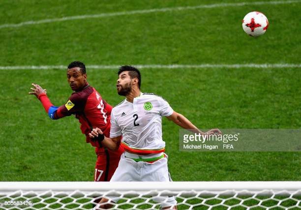 Nani of Portugal and Nestor Araujo of Mexico battle to win a header during the FIFA Confederations Cup Russia 2017 PlayOff for Third Place between...