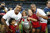 Nani of Portugal Bruno Alves of Portugal with Coupe Henri Delaunay during the UEFA EURO 2016 final match between Portugal and France on July 10 2016...