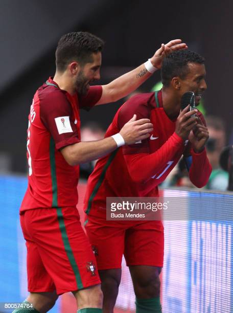 Nani of Portugal celebrates scoring his sides fourth goal with Joao Moutinho of Portugal during the FIFA Confederations Cup Russia 2017 Group A match...