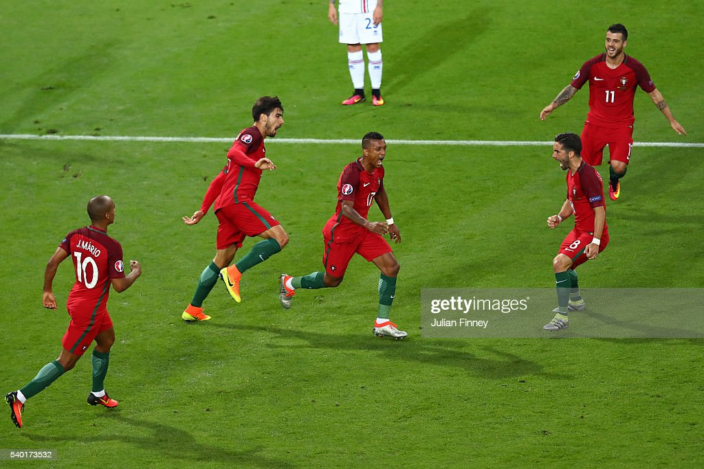 Nani of Portugal celebrates scoring his team's first goal with his team mates during the UEFA EURO 2016 Group F match between Portugal and Iceland at...