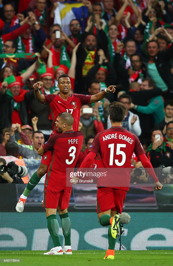 Nani of Portugal celebrates scoring his team's first goal with his team mates Pepe and Andre Gomes during the UEFA EURO 2016 Group F match between...