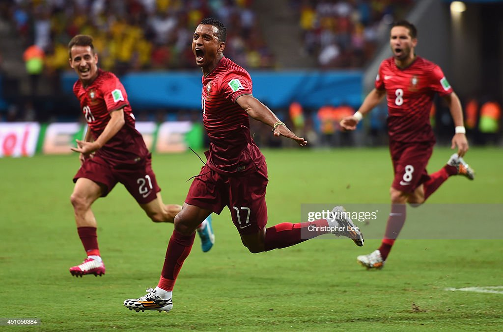 Nani of Portugal (C) celebrates scoring his team's first goal with teammates Joao Pereira (L) and Joao Moutinho of Portugal (R) during the 2014 FIFA World Cup Brazil Group G match between the United States and Portugal at Arena Amazonia on June 22, 2014 in Manaus, Brazil.