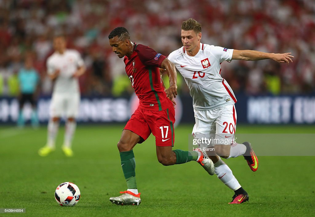 <a gi-track='captionPersonalityLinkClicked' href=/galleries/search?phrase=Nani+-+Soccer+Player&family=editorial&specificpeople=11510994 ng-click='$event.stopPropagation()'>Nani</a> of Portugal controls the ball under pressure of <a gi-track='captionPersonalityLinkClicked' href=/galleries/search?phrase=Lukasz+Piszczek&family=editorial&specificpeople=4380352 ng-click='$event.stopPropagation()'>Lukasz Piszczek</a> of Poland during the UEFA EURO 2016 quarter final match between Poland and Portugal at Stade Velodrome on June 30, 2016 in Marseille, France.