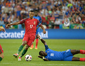 Nani of Portugal evades the challenge of Moussa Sissoko of France during the UEFA EURO 2016 Final match between Portugal and France at Stade de...
