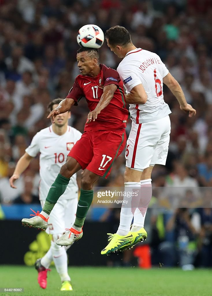 Nani (17) of Portugal in action against Tomasz Jodlowiec (6) of Poland during the Euro 2016 quarter-final football match between Poland and Portugal at the Stade Velodrome in Marseille, France on June 30, 2016.