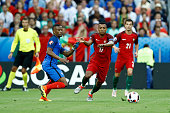 Nani of Portugal is challenged by Patrice Evra of France during the UEFA Euro 2016 Final match between Portugal and France at Stade de France on July...