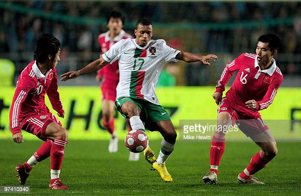 Nani of Portugal is challenged by Rong Hao and Zheng Zhi of China during the International Friendly match between Portugal and Republic of China at...