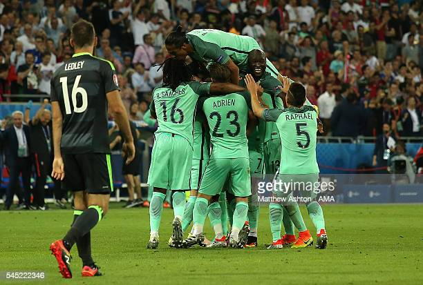 Nani of Portugal is mobbed by his teammates after scoring a goal to make the score 20 during the UEFA Euro 2016 Semi Final match between Portugal and...