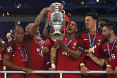 Nani of Portugal lifts the trophy following the UEFA Euro 2016 Final match between Portugal and France at Stade de France on July 10 2016 in Paris...