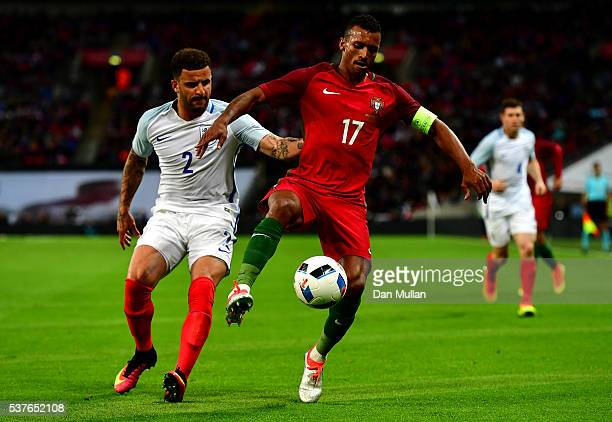 Nani of Portugal takes on Kyle Walker of England during the international friendly match between England and Portugal at Wembley Stadium on June 2...