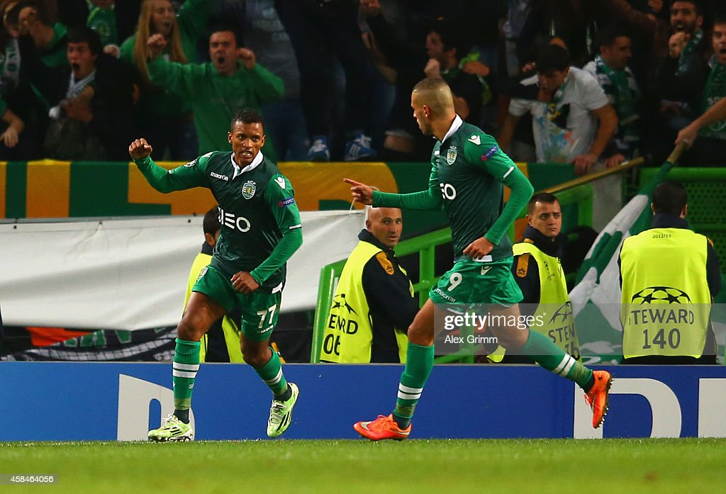 Nani of Sporting Lisbon celebrates scoring their fourth goal with Islam Slimani of Sporting Lisbon during the UEFA Champions League Group G match between Sporting Clube de Portugal and FC Schalke at Estadio Jose Alvalade 04 on November 5, 2014 in Lisbon, Portugal.