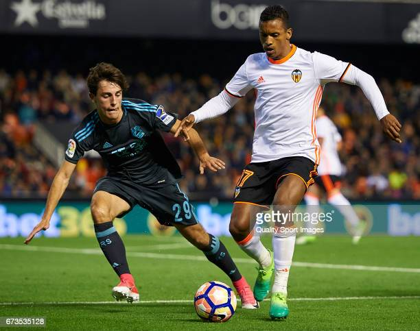 Nani of Valencia competes for the ball with Alvaro Odriozola of Real Sociedad during the La Liga match between Valencia CF and Real Sociedad de...
