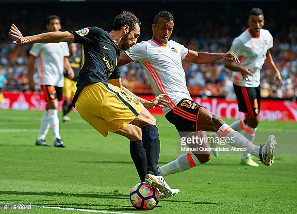 Nani of Valencia competes for the ball with Juanfran Torres of Atletico de Madrid during the La Liga match between Valencia CF and Atletico de Madrid...