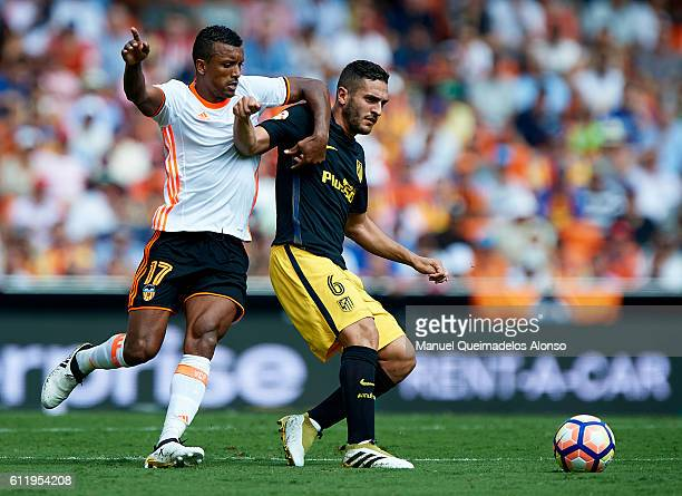 Nani of Valencia competes for the ball with Koke of Atletico de Madrid during the La Liga match between Valencia CF and Atletico de Madrid at...