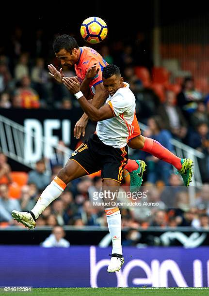 Nani of Valencia competes for the ball with Mathieu Saunier of Granada during the La Liga match between Valencia CF and Granada CF at Mestalla...
