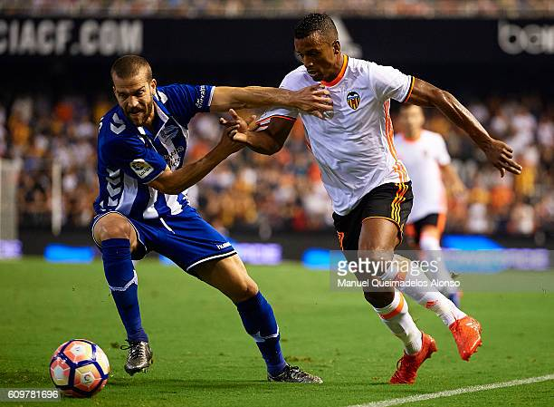 Nani of Valencia competes for the ball with Victor Laguardia of Deportivo Alaves during the La Liga match between Valencia CF and Deportivo Alaves at...