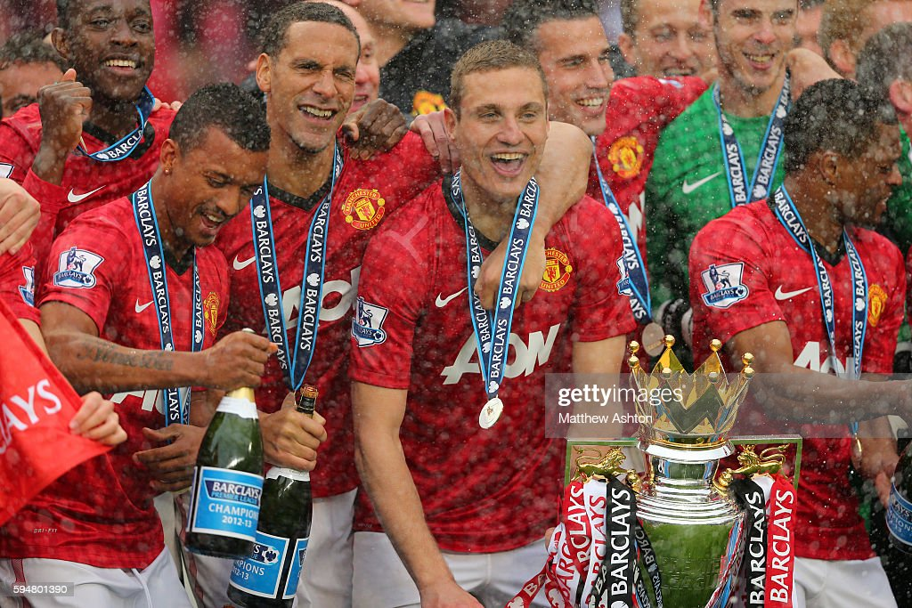 Nani Rio Ferdinand and Nemanja Vidic of Manchester United celebrate being Barclays Premier League champions