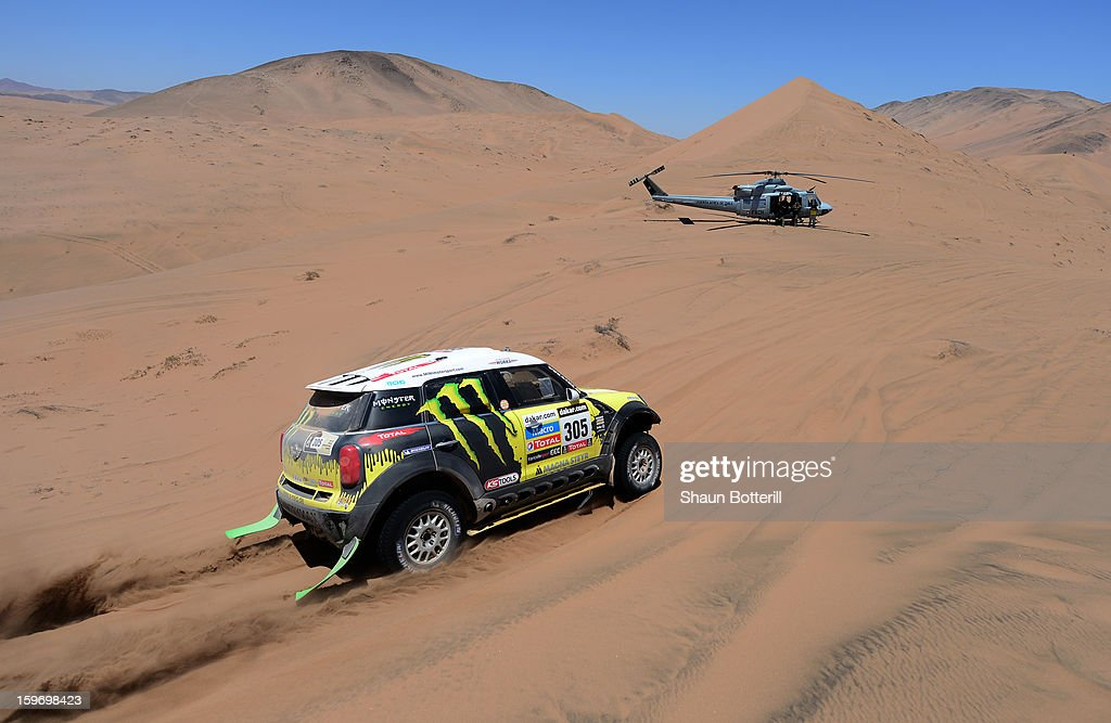 Nani Roma and co-driver Michel Perin of team Mini compete in stage 13 from Copiapo to La Serena during the 2013 Dakar Rally on January 18 in Copiapo, Argentina.