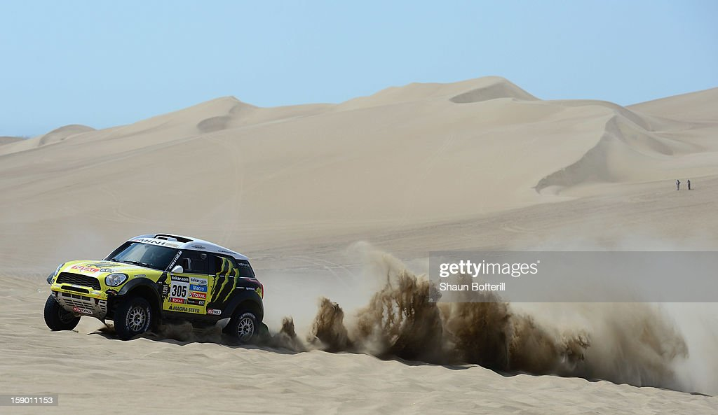 Nani Roma and co-pilot Michel Perin of team Mini compete during the special stage of day one of the of the 2013 Dakar Rally on January 5, 2013 in Pisco, Peru.