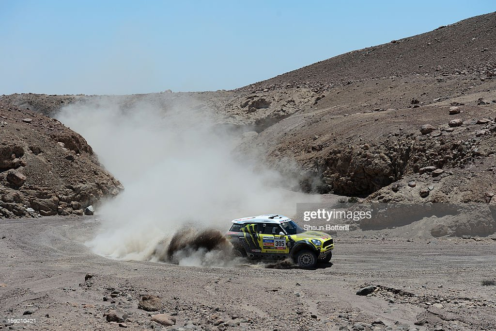 Nani Roma and co-pilot Michel Perin of team Mini compete in stage 5 from Arequipa to Arica during the 2013 Dakar Rally on January 9, 2013 in Arequipa, Peru.